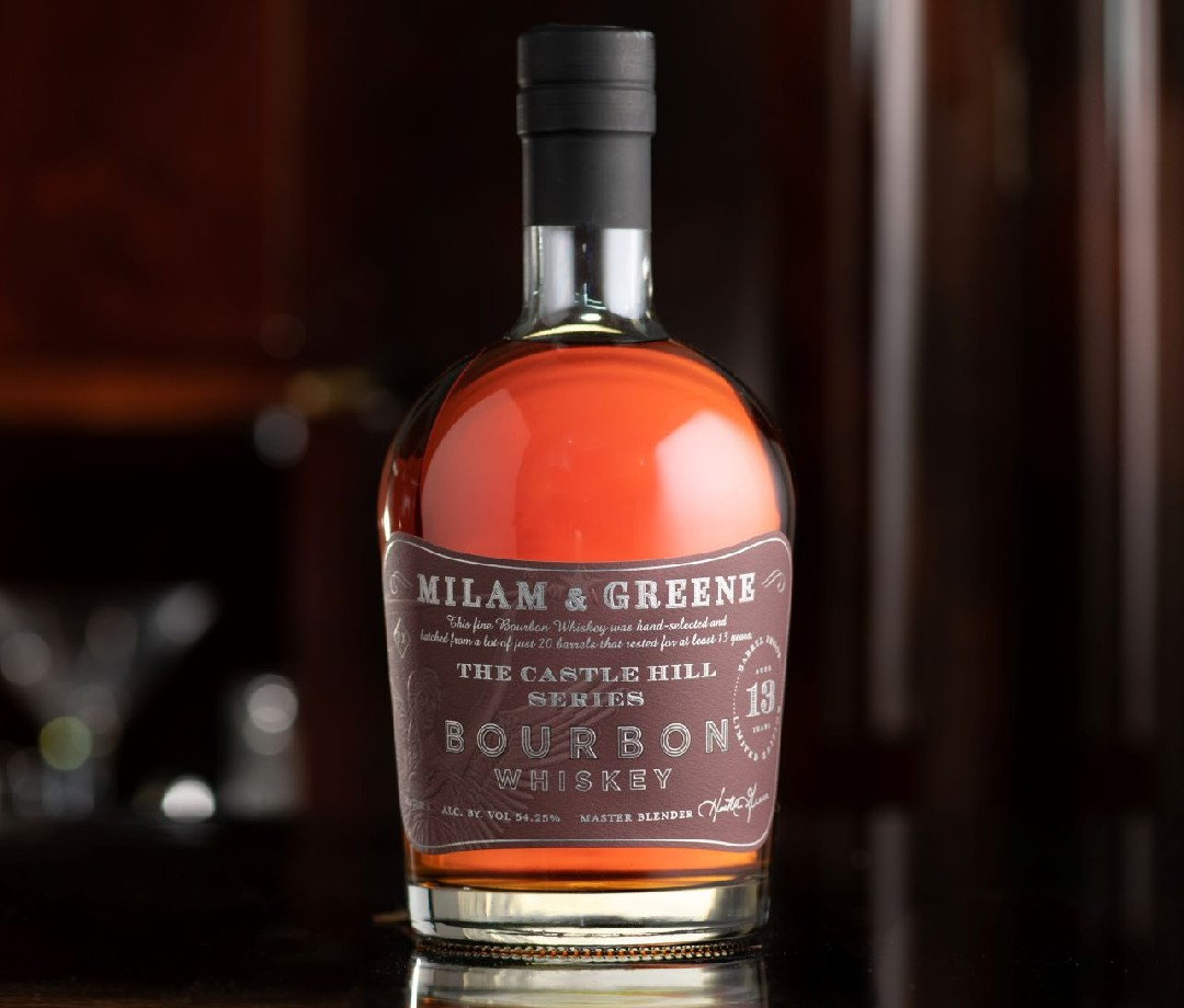 A bottle of Milam and Greene Castle Hill Series Bourbon.