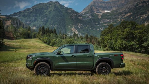Exterior of 2022 Nissan Frontier truck with mountains in the background
