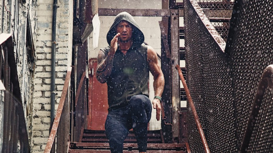 Man running downstairs in workout clothes in the rain