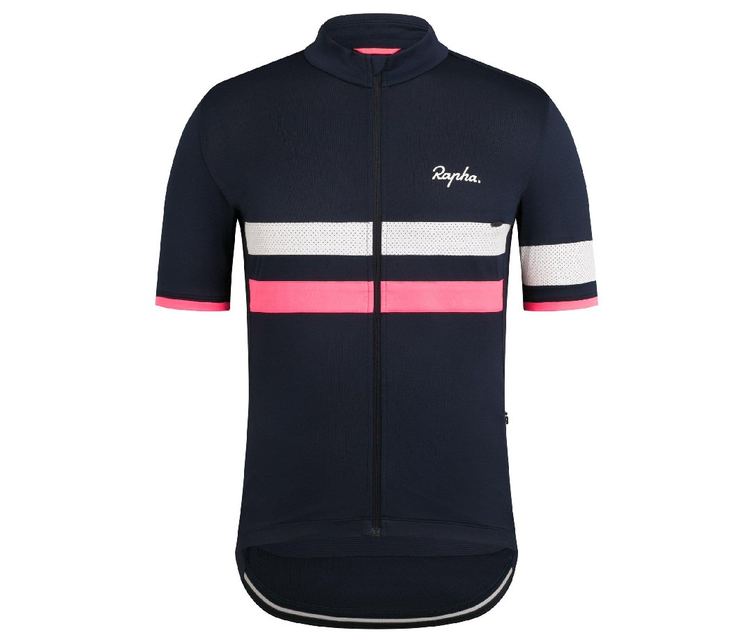 An image of a navy Rapha Brevet Lightweight Jersey with white and pink stripes.