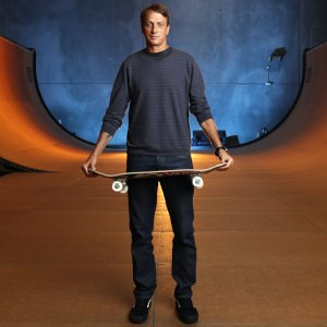 Tony Hawk stands on his halfpipe at his warehouse