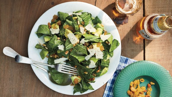Kale salad with golden raisins and Parmesan cheese with a beer