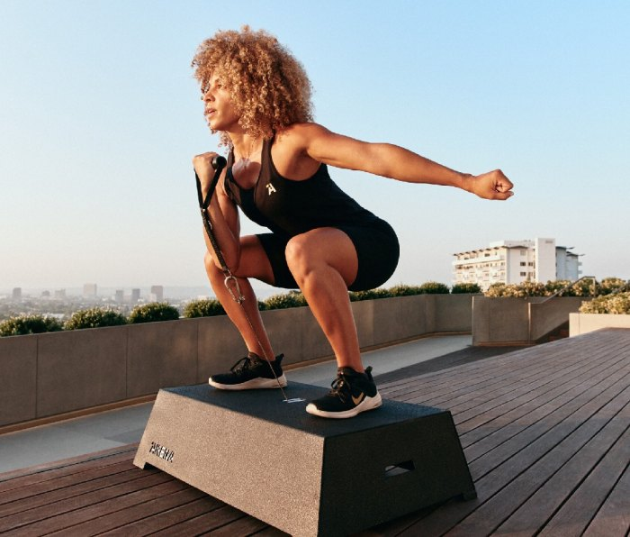 Woman standing on top of Arena exercise machine