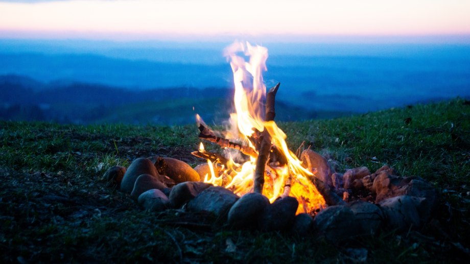 campfire burning on a mountain