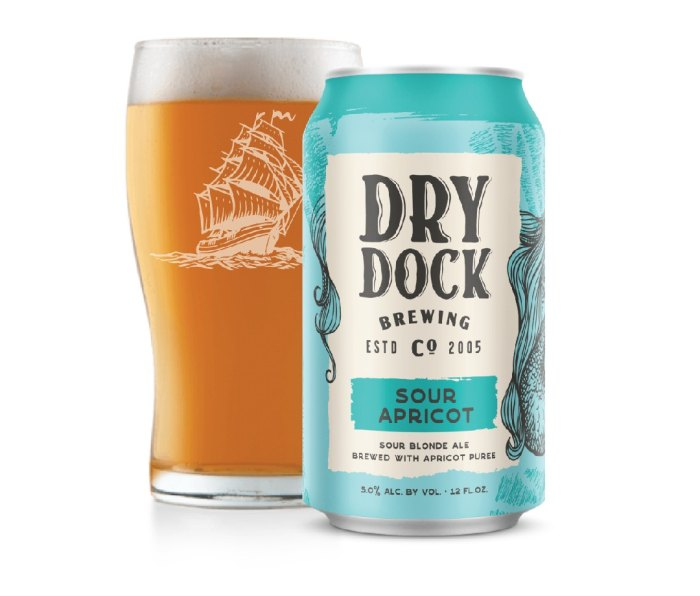 12 oz can and pint glass of Dry Dock Apricot Sour beer