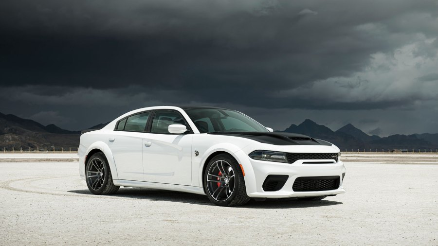 White and black sport car with black clouds overhead