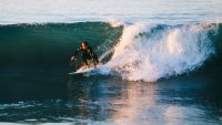 insulated wetsuits man surfing in cold water