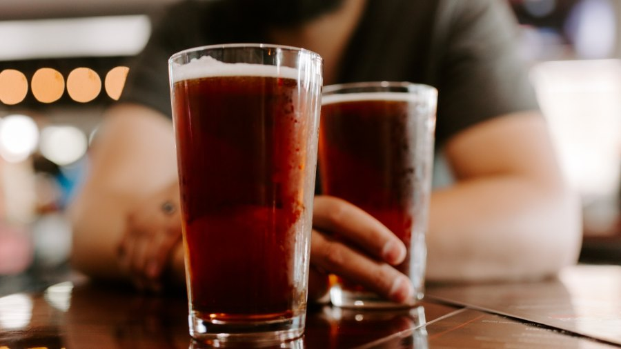 Man drinking non-pumpkin fall beers at a table