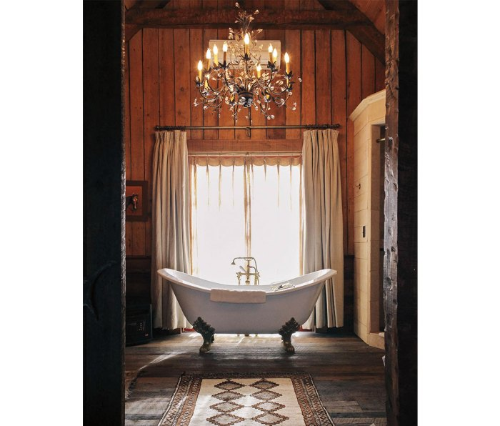 Clawfoot tub with chandelier above