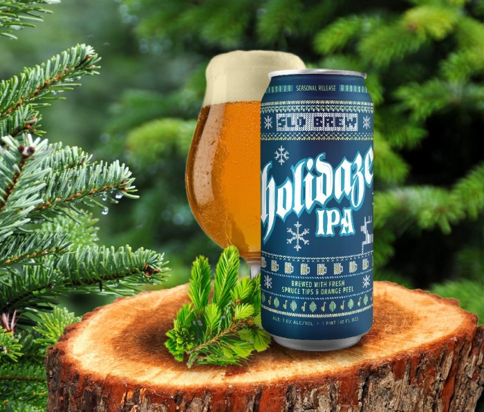 Can of SLO Brew Holidaze IPA beer beside a pint glass of