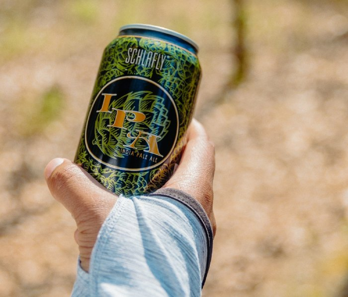 Hand holding a can of Schlafly IPA beer