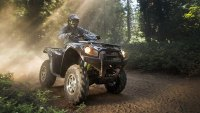 Driving an ATV through the woods of West Virginia