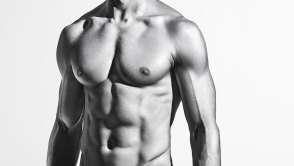 Black and white portrait of hirtless man with six-pack abs