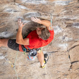Male climber scaling rock face