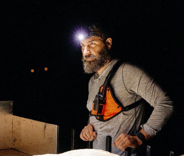 Man with headlamp and vest on