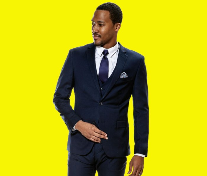 Black man wearing tux against bright yellow backdrop