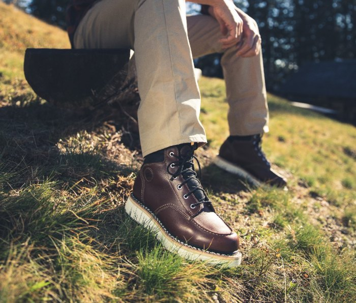 Brown leather boot with white midsole
