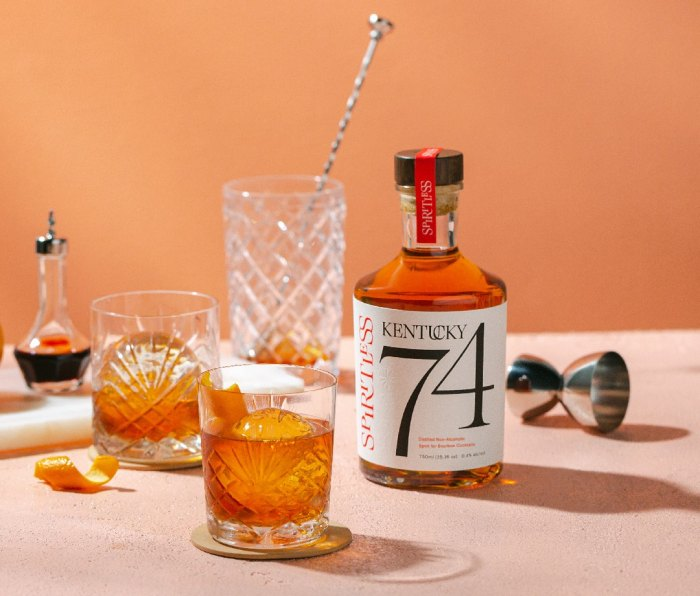 Bottle of Spiritless Kentucky 74 on a table with mixing glass