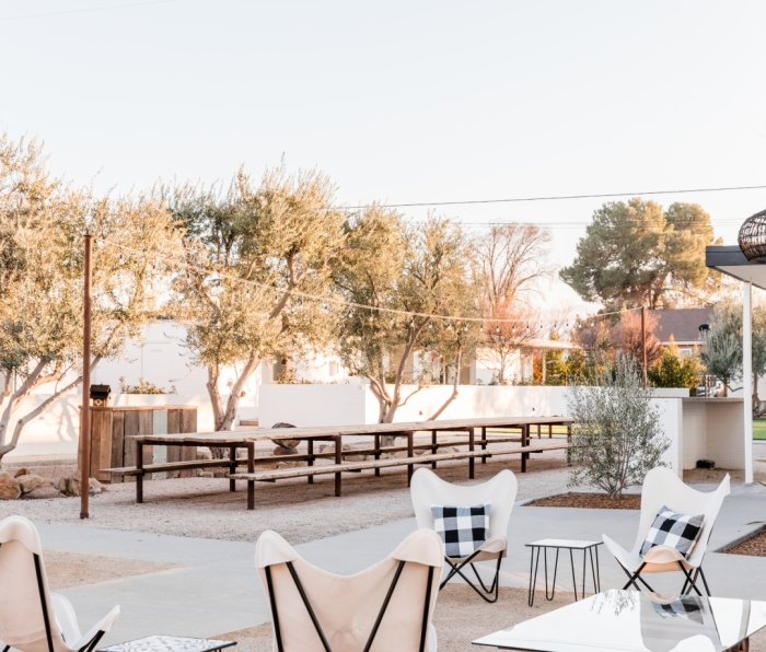The patio and white chairs at the Cuyama Buckhorn hotel