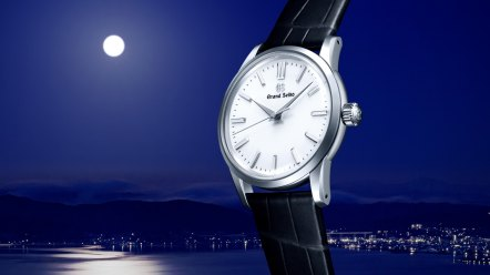 Grand Seiko Elegance Collection watch against a night sky with a full moon