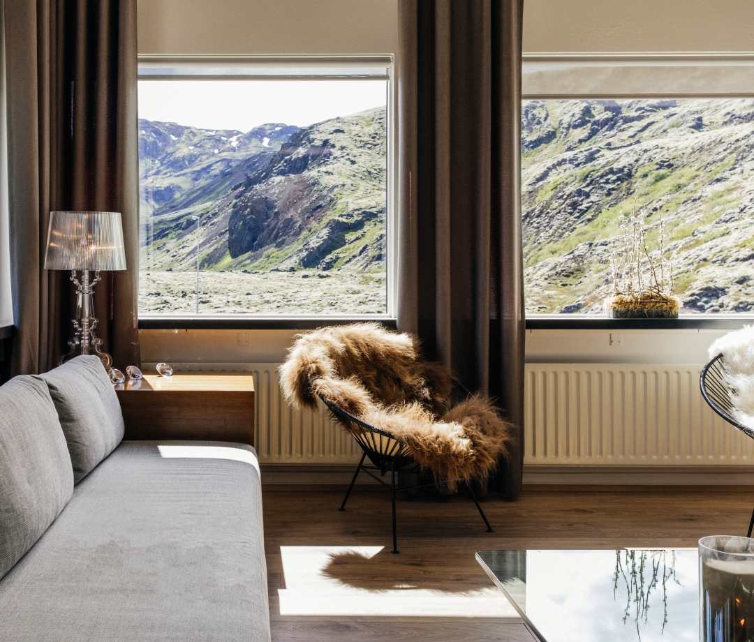 Design Hotels: Ion Adventure Hotel, room with a furry blanket on a chair