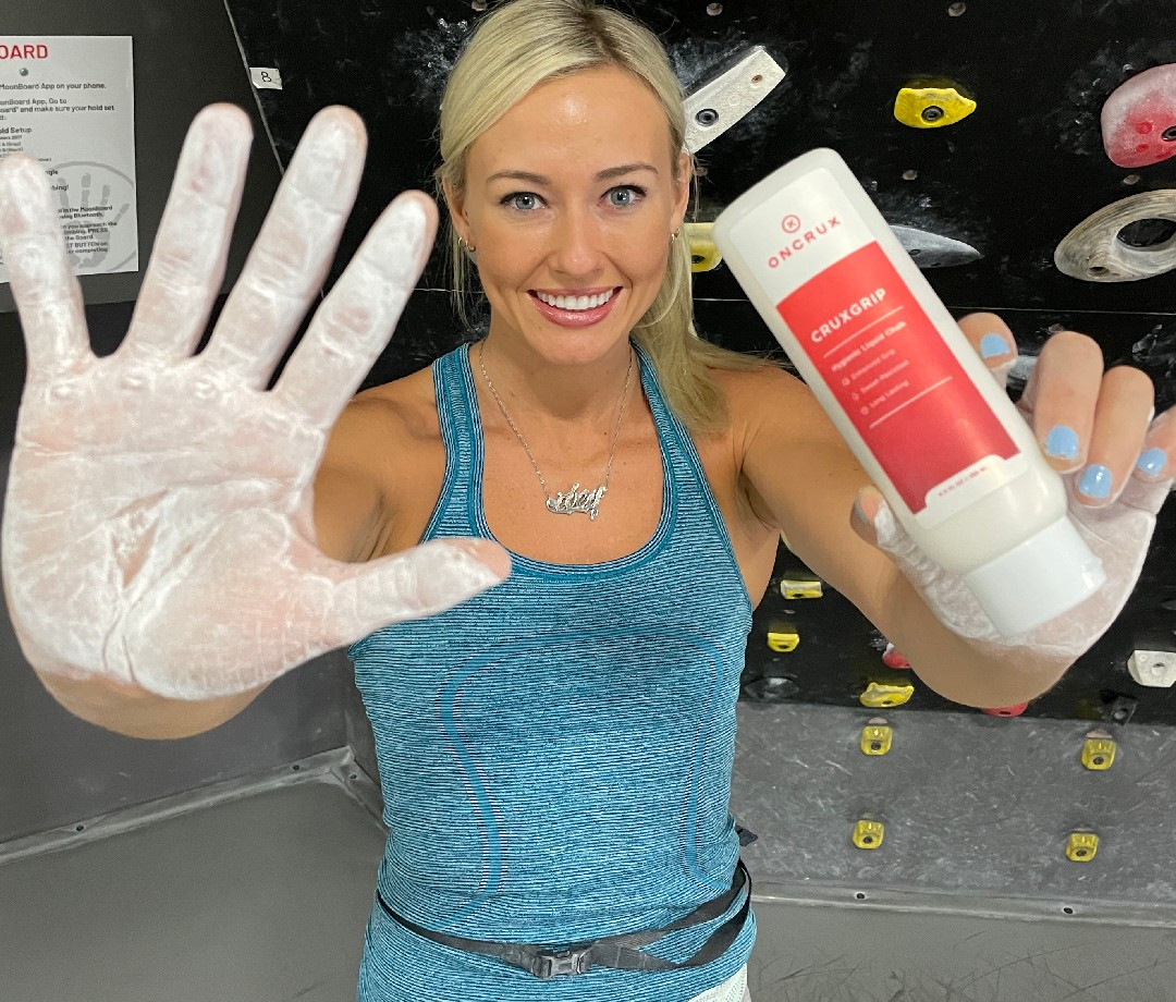 Pro climber and OnCrux athlete Sierra Blair-Coyle shows off a chalked hand