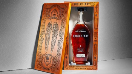 Bottle of Angel's Envy Cask Strength whiskey in box engraved with wings