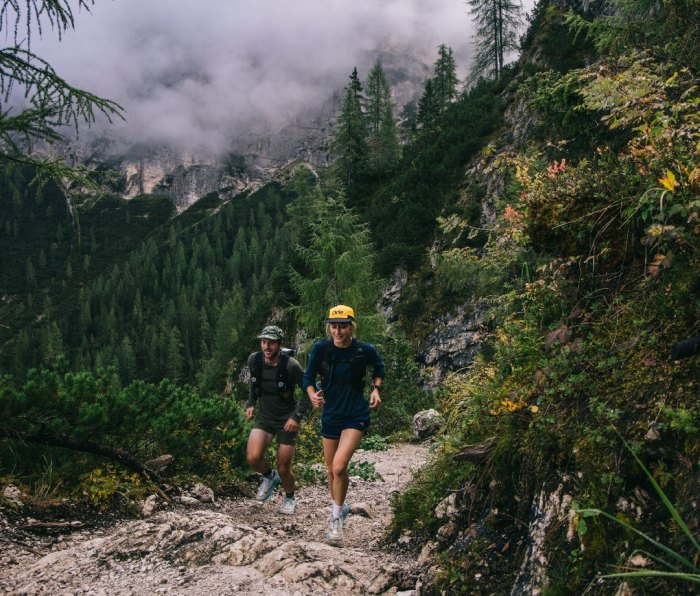 Trail runners in wooded area