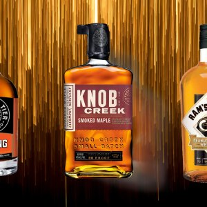 Lineup of flavored whiskey bottles