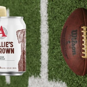 Avery Ellie's Brown next to football on field