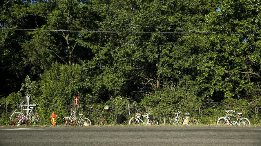 Five ghost bikes in memory of five cycling victims are seen during the Peace-Pedal-Pray memorial ride in Kalamazoo, Mich. on Sunday, June 12, 2016. The ride honored the five cyclists killed and four injured in a hit-and-run crash on Tuesday, June 7, 2016. Hundreds participated in the 7.5 mile ride that rode part of the route the cyclists had taken that night.