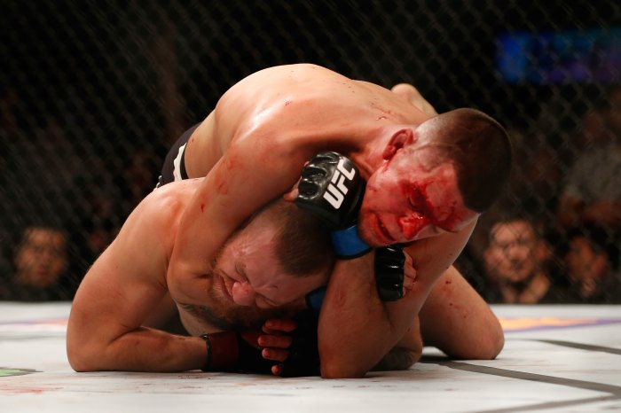 Nate Diaz (top) attempts to submit Conor McGregor of Ireland in their welterweight bout during the UFC 196 event inside MGM Grand Garden Arena on March 5, 2016 in Las Vegas, Nevada.