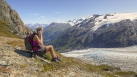 A woman talks on her cell phone in Kenai Fjords National Park.