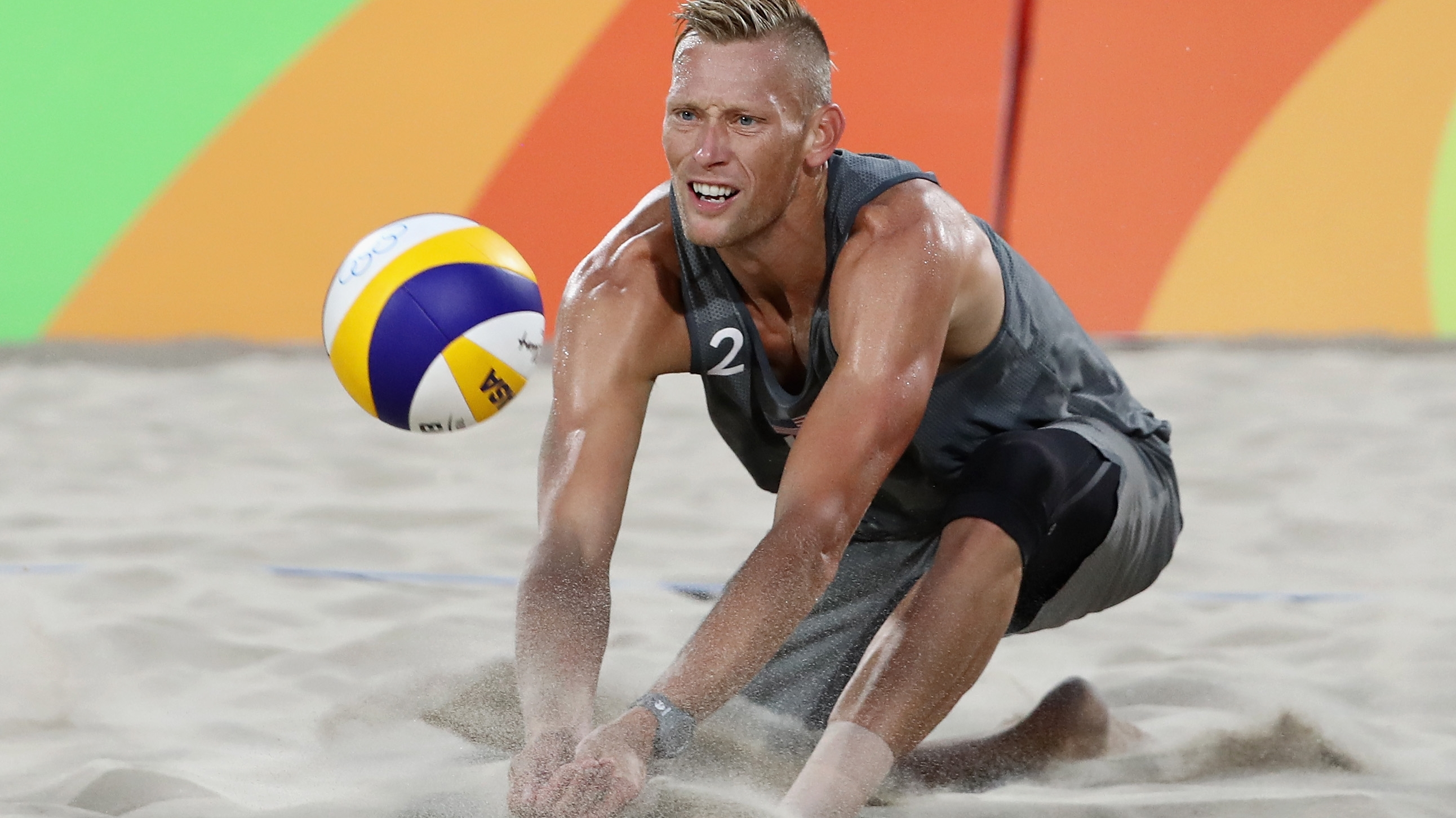 Casey Patterson of United States dives for the ball during the Men's Beach Volleyball preliminary round Pool F match against Robin Seidl and Alexander Huber of Austria on Day 3 of the Rio 2016 Olympic Games at the Beach Volleyball Arena on August 8, 2016.