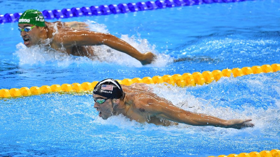 Michael Phelps (R) of the United States leads Chad le Clos of South Africa in the Men's 200m Butterfly Final on Day 4 of the Rio 2016 Olympic Games at the Olympic Aquatics Stadium on August 9, 2016 in Rio de Janeiro, Brazil.