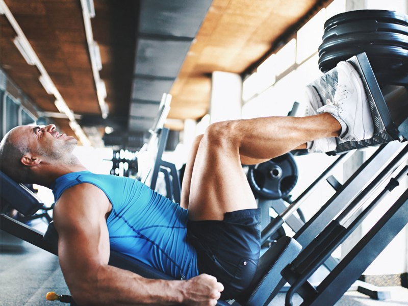 Man Doing Leg Press Exercise
