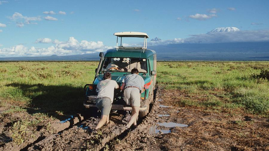 Couple Pushing Car Out of Mud