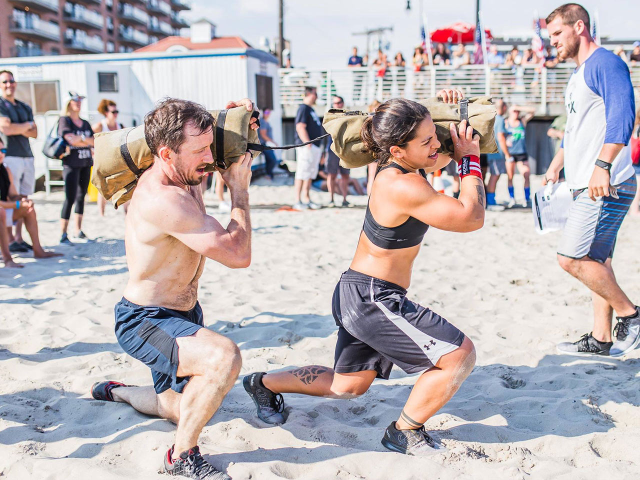 """Derek Godwin and Moran Dankner of team """"Marriage Material"""" compete at Flex on the Beach in Long Beach, NY."""