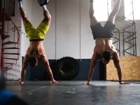 Two men doing handstand pushups