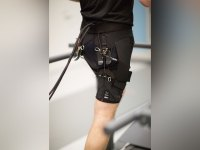 Man running in Harvard's running efficiency-boosting exosuit