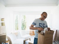 Guy Moving Into House Boxes Unpacking