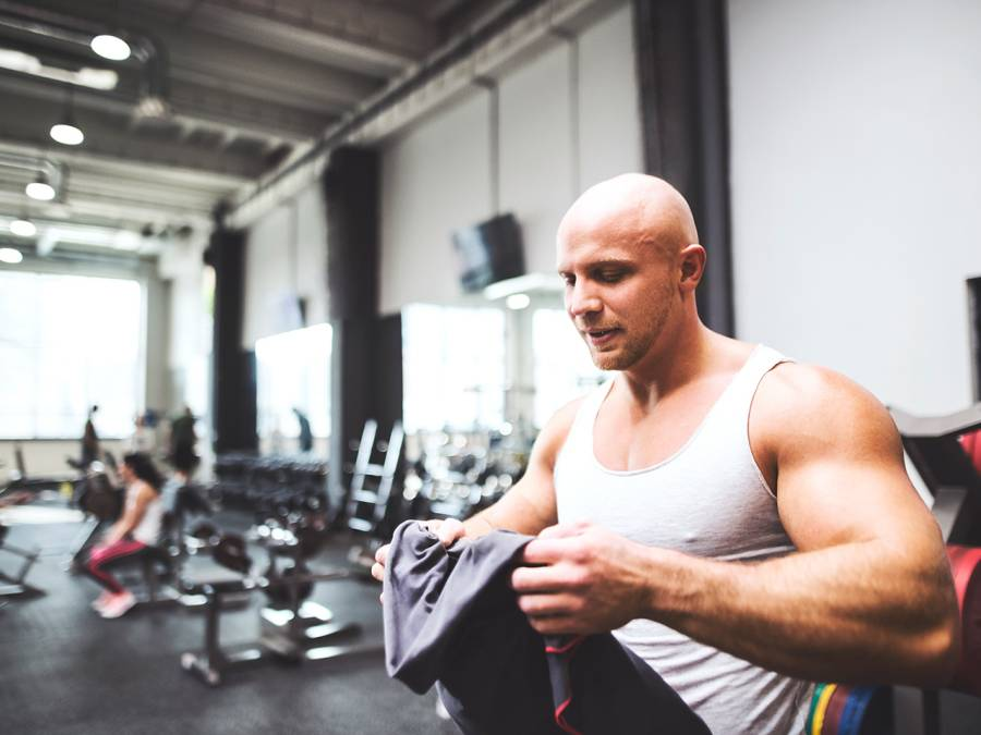 Man Holding Towel in Gym
