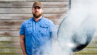 Chef Jean-Paul Bourgeois mans a grill-turned-smoker.