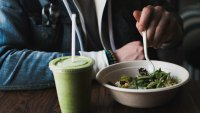 Man having a healthy salad and green smoothie.