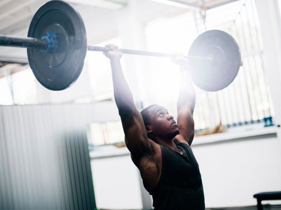Man Lifting Barbell with Weights