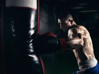 Man Punching Heavy Bag