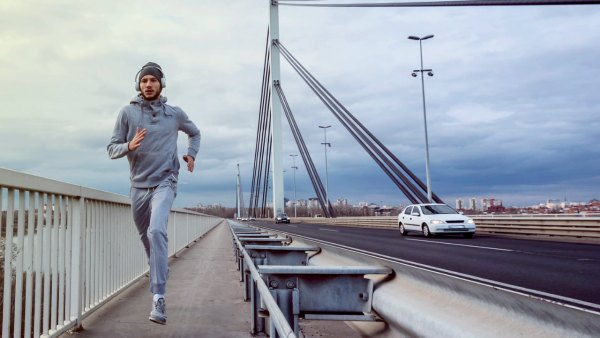 Man Running Across Bridge
