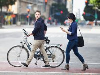 Man Crossing the Street With Bike