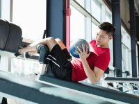 Man Exercising with Medicine ball at Fitness Center