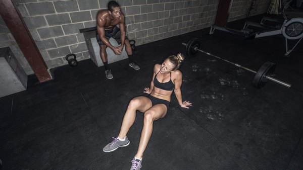 Man and Woman sitting having a break in gym